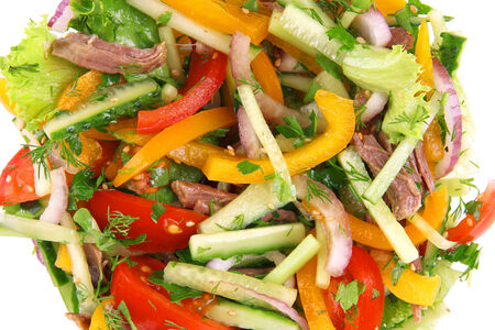 Beef salad on plate close up photo