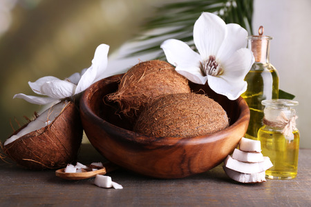 Coconuts and coconut oil on wooden table Stock Photo