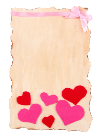 Beautiful sheet of paper with decorative hearts, isolated on white photo