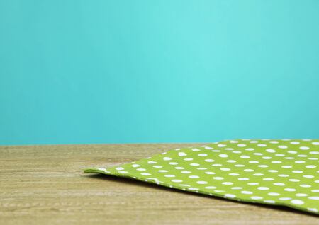 Background with wooden table and tablecloth photo