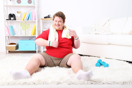 Large fitness man working out  at home Stock Photo
