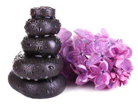 Composition with spa stones and lilac flowers, isolated on white photo