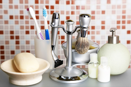 raiser: Male luxury shaving kit on shelf in bathroom Stock Photo