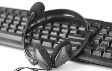 Headphone and keyboard, close-up, isolated on white photo