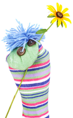 Cute sock puppet isolated on white photo