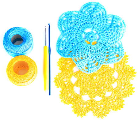 Colorful yarn for knitting with napkin and crochet hook, isolated on white photo