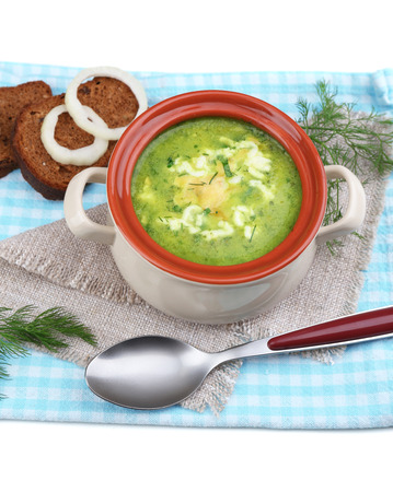 Tasty soup in saucepan, isolated on white photo