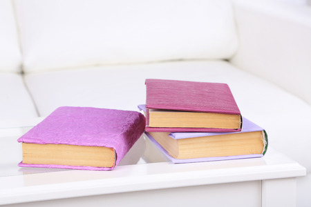 violet residential: Books on coffee table in room
