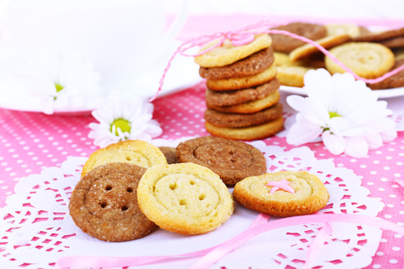 Sugar cookies in shape of buttons on table photo