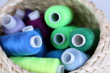 wicker work: Multicolor sewing threads background Stock Photo