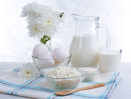 Tasty dairy products on wooden table photo