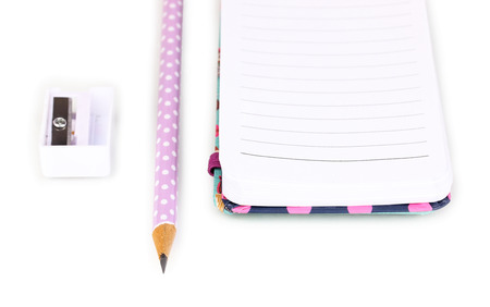 undermine: Pencil, pencil sharpener and notepad isolated on white