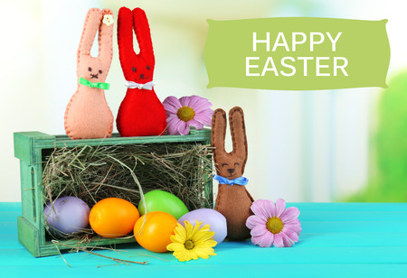 Composition with funny handmade Easter rabbits  photo