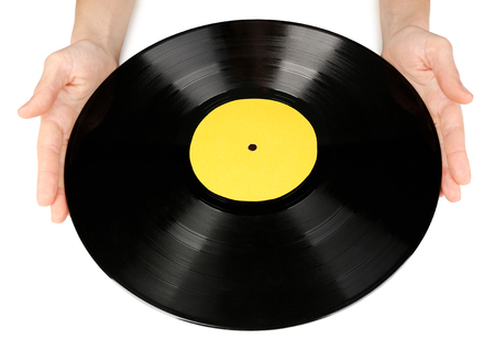 Hands holding old vinyl record, isolated on white photo