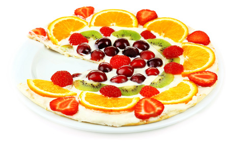 Homemade sweet pizza with fruits isolated on white photo