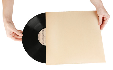 Hands holding old vinyl record in paper case, isolated on white photo
