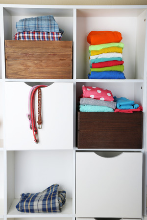 Clothes on shelves close-up photo