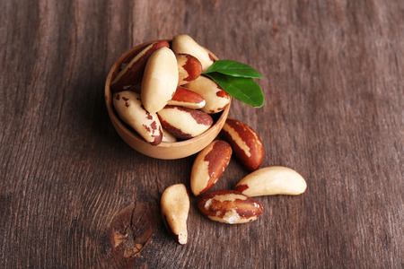 nutriment: Tasty brasil nuts on wooden background Stock Photo