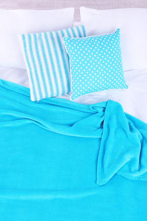 Unmade bed close up photo