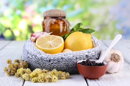 colds: Folk remedies for colds on table on natural background