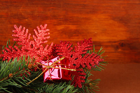 Beautiful Christmas decorations on fir tree on table on wooden background photo