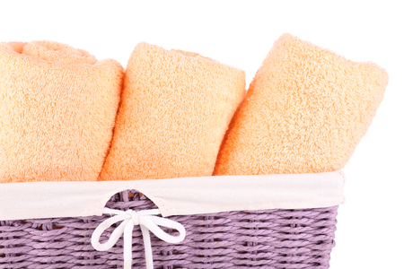 wicket: Color towels in wicket basket, isolated on white