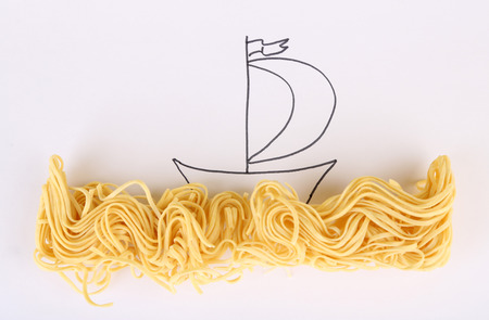 Beautiful still life composition with vermicelli. Food art concept. Isolated on white photo