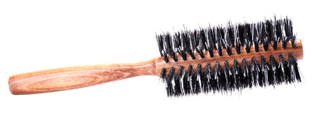 Wooden hairbrush isolated on white  photo