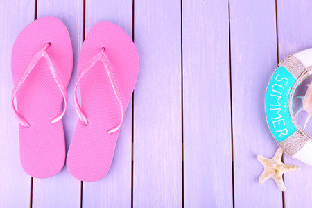Bright flip-flops on color wooden background Stock Photo - 29674013