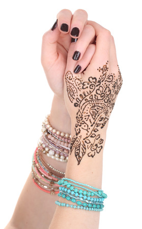Hands painted with henna, isolated on white photo