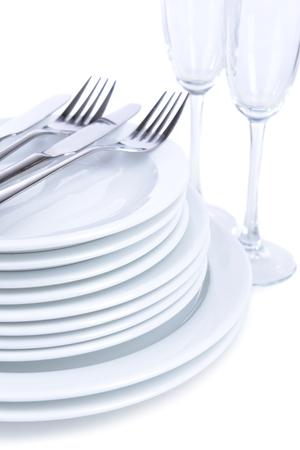 Set of white dishes isolated on white photo