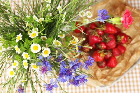 Beautiful wild flowers in vase on table photo