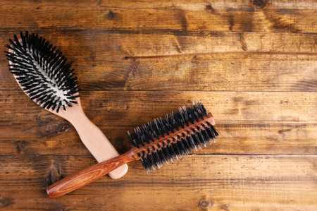 Wooden hairbrushes on wooden background photo
