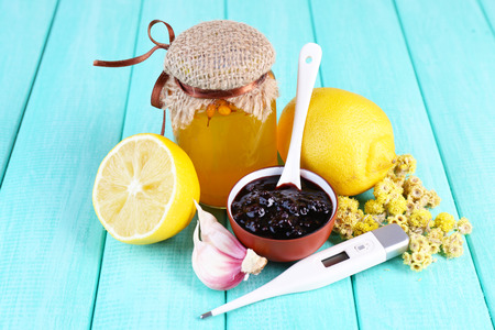 colds: Folk remedies for colds on wooden table