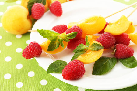 healthy snack: Fresh fruit kebabs for healthy snack on plate close up