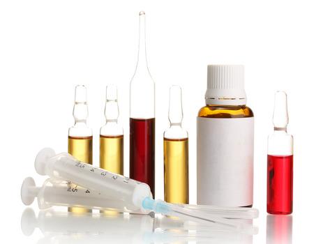 medical ampules, bottle and syringes, isolated on white  photo