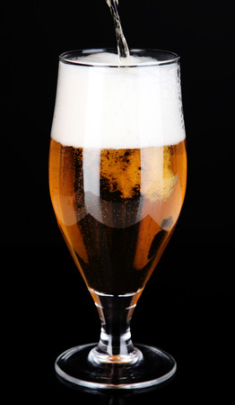 Glass of beer isolated on black photo