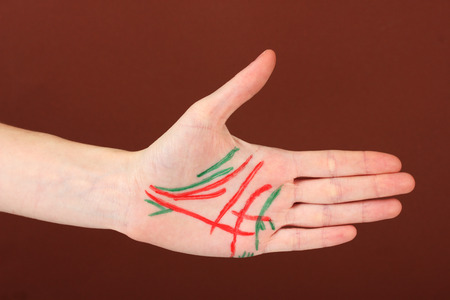 palmistry: Chiromancy.Color contours on palm, on color background Stock Photo