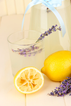 Lavender lemonade, on white wooden background photo
