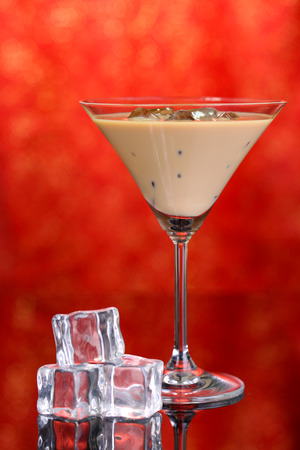 Baileys liqueur in glass on red background photo