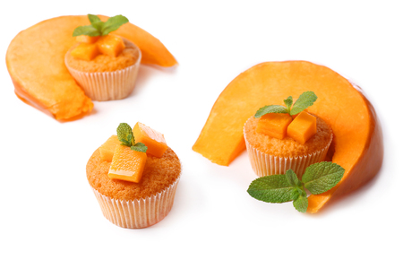 Tasty pumpkin muffins, isolated on white photo