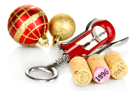 Wine corks with new Year toys isolated on white photo
