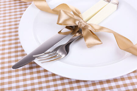 Set of knife and fork on table close-up photo