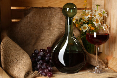 Beautiful still life with bottles of wine photo