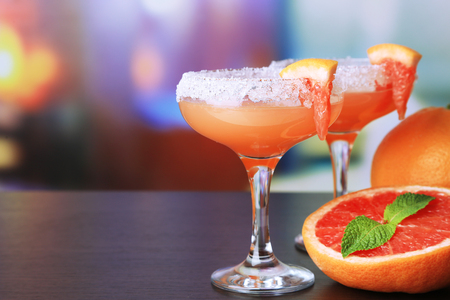 Grapefruit cocktail in glasses on bright background Stock Photo