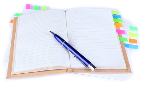 writing utensil: Notebook, pen, and stickers isolated on white