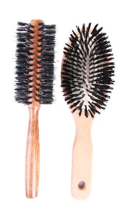 Wooden hairbrushes isolated on white  photo