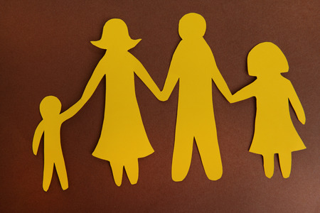 Paper family on brown background photo