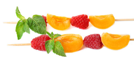 healthy snack: Fresh fruit kebabs for healthy snack isolated on white Stock Photo
