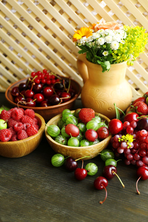 Still life with berries and flowers photo